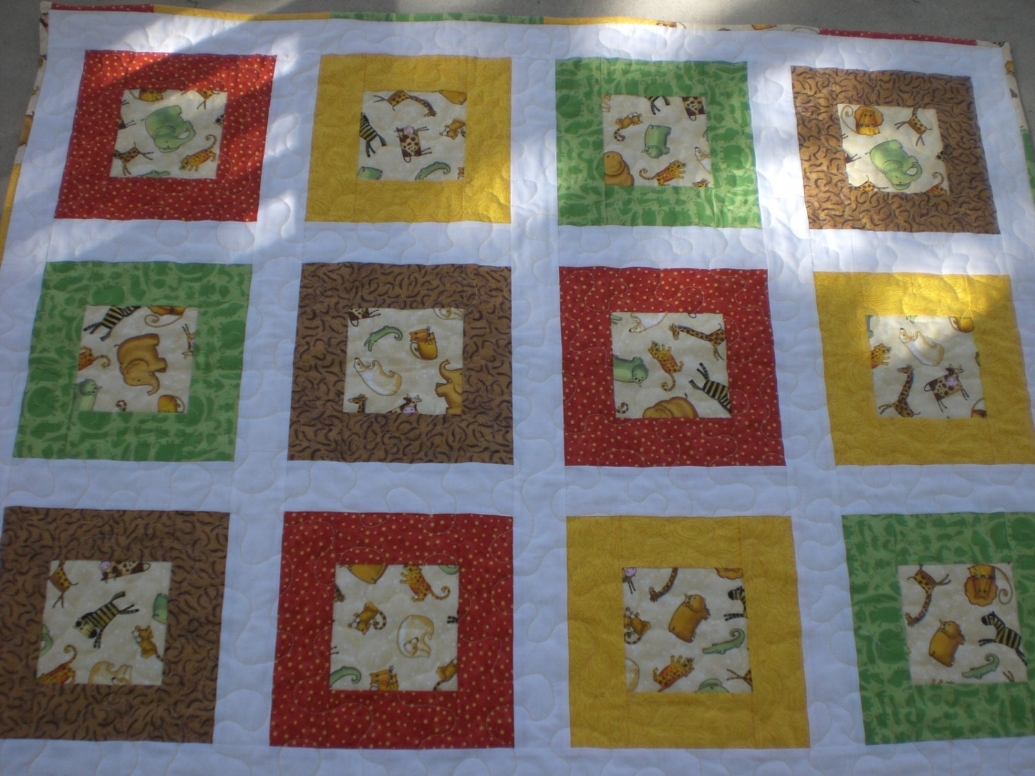 Baby quilt with zoo animals by KeyLimeDesignByJeana on Etsy