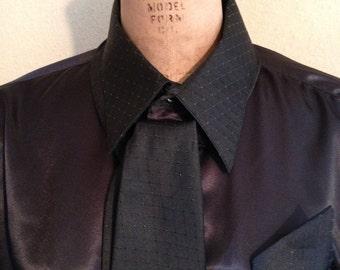 Black long sleeve dress shirt, tie, and handkerchief
