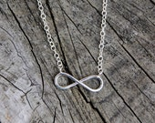 Infinite. Sterling silver Infinity loop charm necklace.