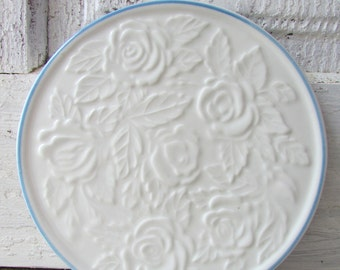 Vintage ceramic blue and white hot pad ,coaster or candle plate