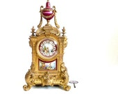 RESERVED FOR R Antique French Sevres porcelain and gilt bronze mantle clock  .