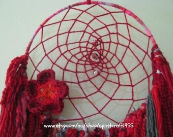 Dreamcatcher -  Wall Hanging - Home decor - Suncatcher Ruby Red with novelty yarns in rich reds and soft grey that hang down. Crochet flower