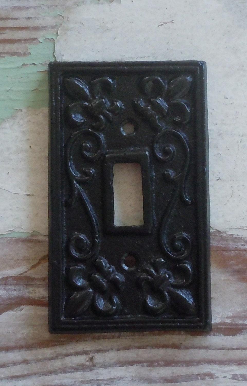 Cast iron fleur de lis cover for light switch black
