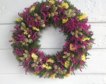 Colorful pink and yellow dried flower spring wreath