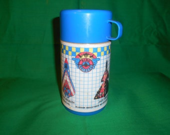 One(1), 1988 Aladdin Industries  Ring Raiders Thermos.