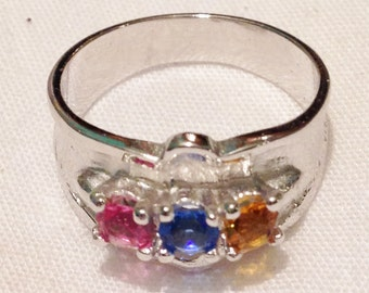 Silver ring with pink, blue & amber stones