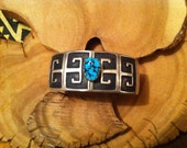 Hopi Cuff Carved and Oxidized Sterling Unisex with a Floated Turquoise Nugget : 1 Inch Wide Distinctive and Unique