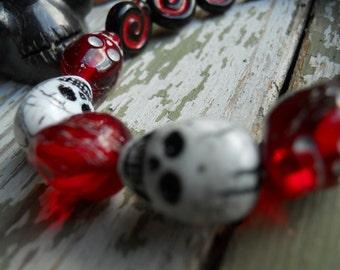 The Real Dia de Los Muertos Cardinal Colors Skull bracelet in University of Louisville colors plus white