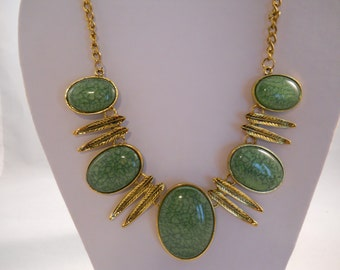 Lime Green Pendant Bib Necklace with Gold Tone Dangles on a Gold Tone Chain