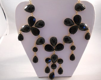 Bib Necklace with Gold Tone and Black Pendants and Beads on a Gold Tone Chain