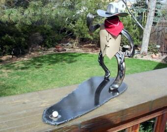 cowboy golfer sculpture