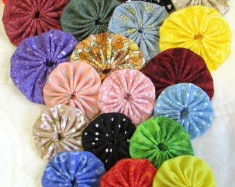 yo yos  multi color 250 piece assortment  2 inch and 1 1/2 inch 125 of each.