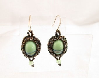 Earrings Green striped cabachons are bead embroidered with gold and green seed beads and a crystal dangle