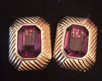 Vintage Jewelry lovely Panetta ameythst clip earrings signed.