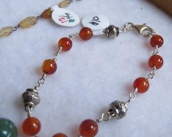 Orange Carnelian and silver bead hand wire wrapped bracelet.