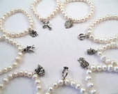 Set of Nine Cake Pulls on Freshwater Pearl Bracelets