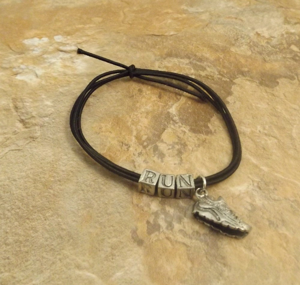 black stretch cord bracelet with pewter letters that say