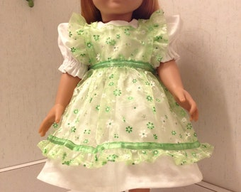 Pretty in green party dress with sheer green daisy pattern pinafore