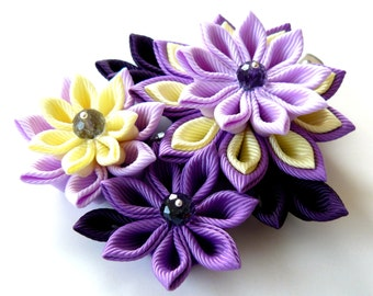 Kanzashi fabric flower hair clip. Shades of purple and yellow.