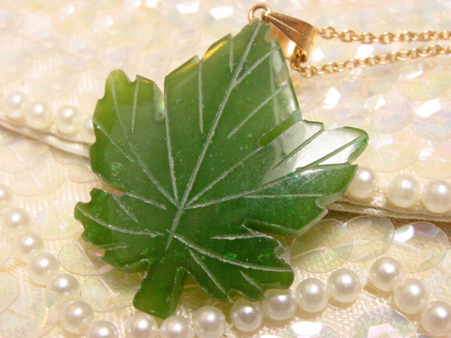 Vintage carved green stone maple leaf pendant by