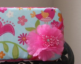 Baby wipe case white  pink and green has a little bird on one side and owls on the otherside.
