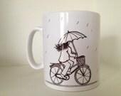 Ceramic Mug with Cyclist in the Rain Illustration