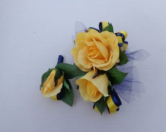 Corsage and matching boutonniere in yellow and navy blue