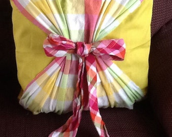 Hand-made bow  throw pillow.