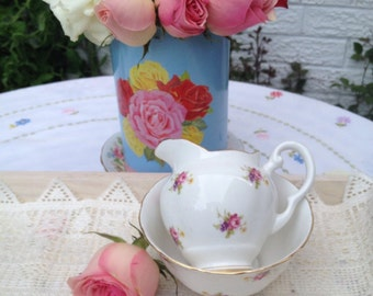 Tuscan Cream and Sugar set in white with tiny little roses and flowers and gold gilding. Milk jug and Sugar Bowl.