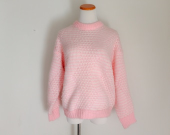 Pink and white knit sweater