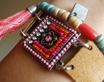 Leather, Suede bracelet with center beaded detail.