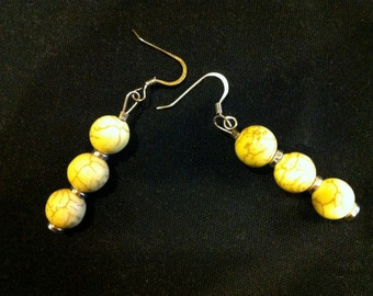 yellow stones with silver trimming