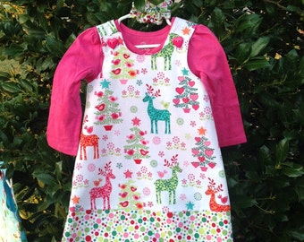 Reindeer Wonderland Christmas Holiday Dress, Jumper, Pink, Red, Green (infant, baby, girl, toddler,child) with matching hair accessory.