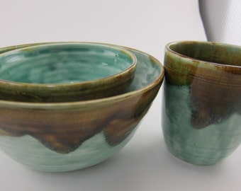 Set of two bowls and a cup