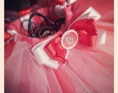 Sports team tutu- up to 11 inches in length with ribbon embellishments and bottlecap bow.