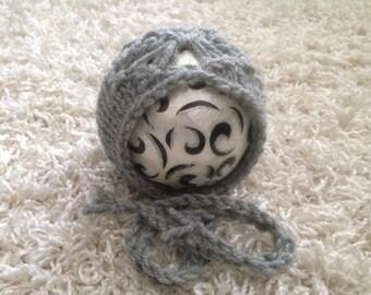 Newborn knit bonnet with butterfly detail