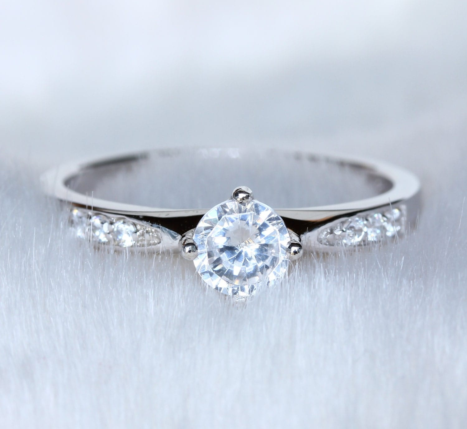 natural white sapphire solitaire ring available in white. Black Bedroom Furniture Sets. Home Design Ideas