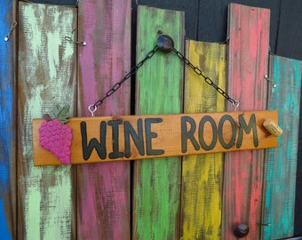 Wine Room sign with wooden grapes and cork attached