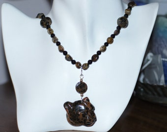 Ref:140/ Petrified wood opal hand carved leopard head pendant necklace.