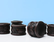 Ebony Serviette holder: The carefully carved reliefs on the these dark wooden holders will make for a talking point at every dinner table.