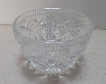 Small, Vintage, lead crystal dish.  It is very elegant with lovely cut stars as shown.