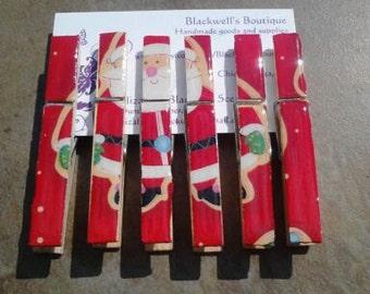 Set of 6 Santa clothes pin magnet clips. Christmas magnets. Holiday magnets.
