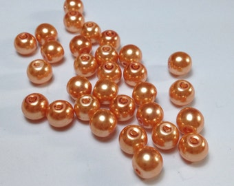 30 pearls orange in acrylic 6mm.