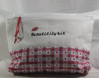 Zippered cosmetic pouch; zippered cosmetic bag; cosmetic bag; beauty bag
