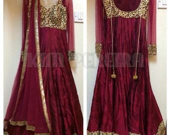 A Wine Colour Anarkali Dress with Net Dupatta and Gold Chudidar