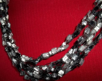 Black and white crochet necklace.