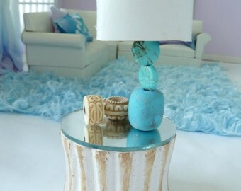 Aqua table lamp with white shade.