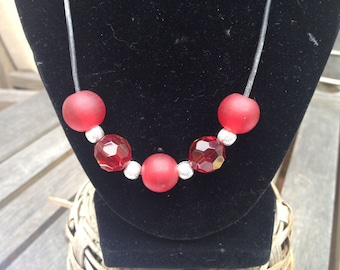 """Elegant matte and faceted 20"""" red glass and sterling silver bead necklace on black leather cord"""