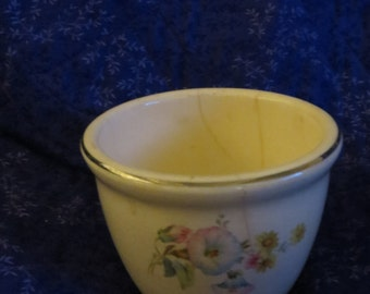 Tiny porcelain glass pot with clematis pink and blue flowers