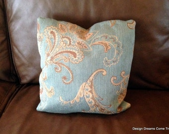 Turquoise and brown tapestry pillow.